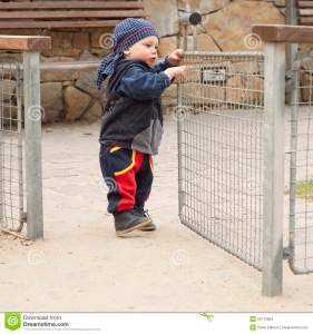 child-opening-gate-23111804