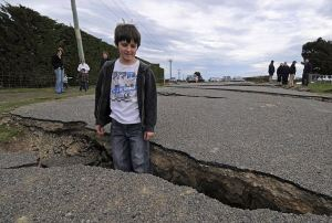 epa02317367 Taylor Strowger (10) from Darfield explores earthquake damage to Highfield Road, 30km west of Christchurch, New Zealand, on 05 September 2010. It will take at least a year to rebuild the  centre of Christchurch, New Zealand Prime Minister John Key said on 05 September as aftershocks continued to rock the city in the wake of a devastating 7.1-magnitude earthquake.  EPA/DAVID WETHEY AUSTRALIA AND NEW ZEALAND OUT